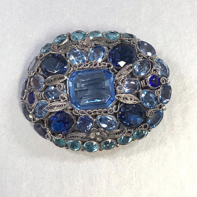 HOBE three-toned blue and aqua rhinestones brooch set in hand wrought gun metal filigree